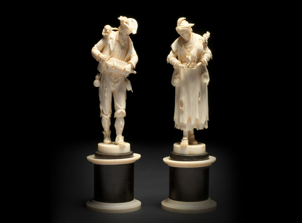 A pair of German carved ivory, depicting a couple of beggars