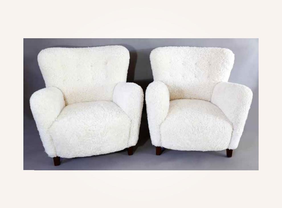 A pair of sheepskin armchairs