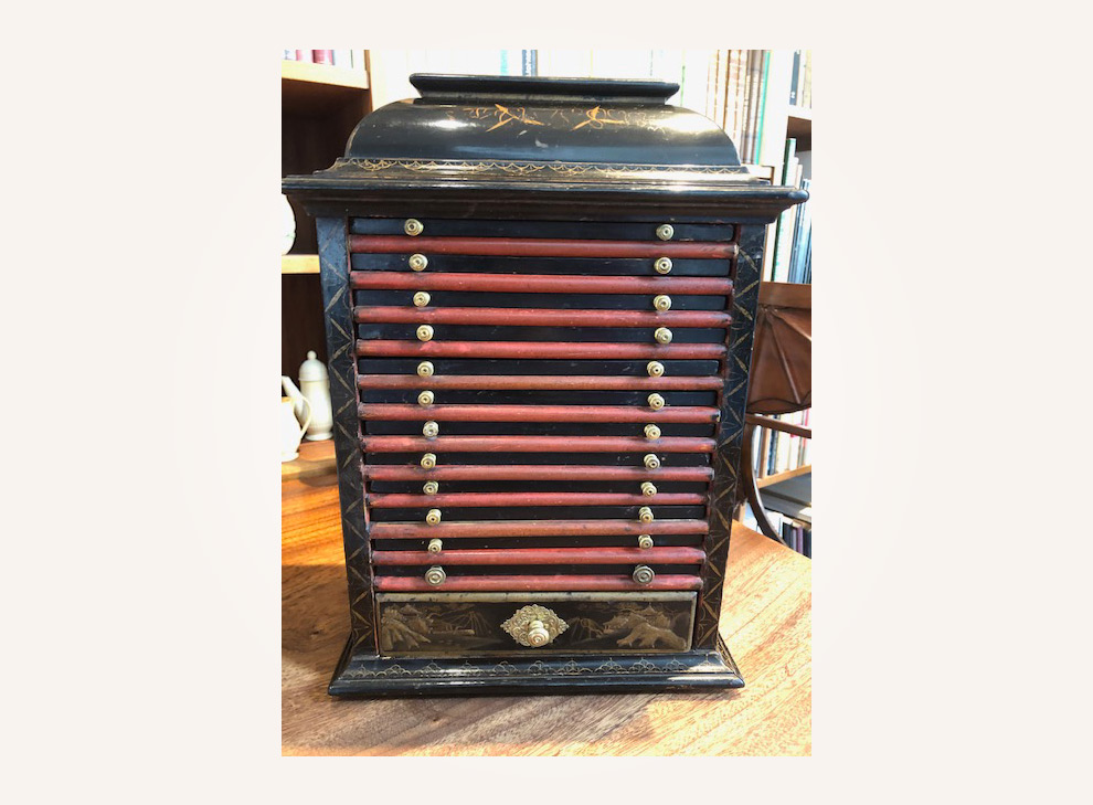 A black lacquered coin cabinet