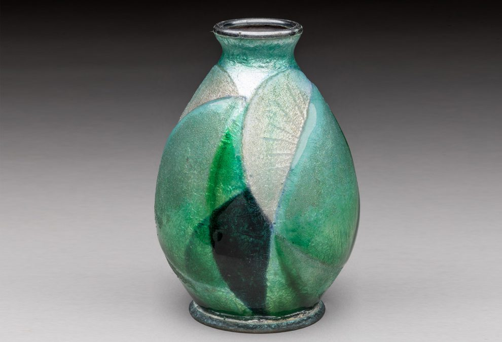 Enameled copper vase with green-white geometric decoration