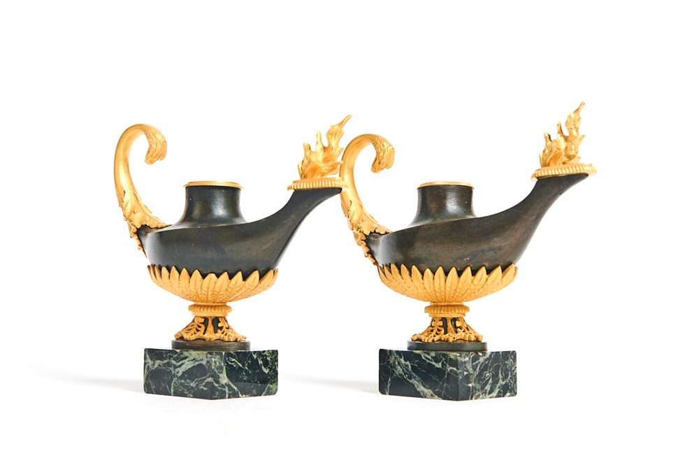 A pair of patinated and gilded Oil lamps