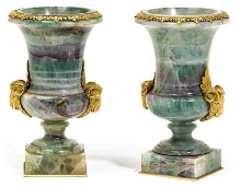A pair of vases with bronze mounts